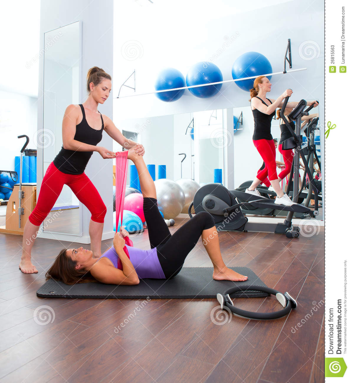 Aerobics pilates gym women group and crosstrainer stock for Gimnasio pilates