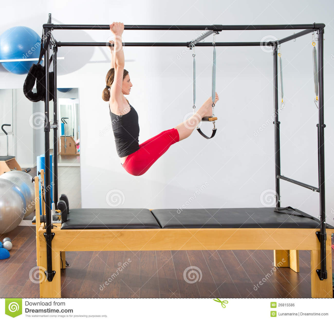Woman Pilates Chair Exercises Fitness Stock Photo: Aerobics Pilates Instructor Woman In Cadillac Stock Photo