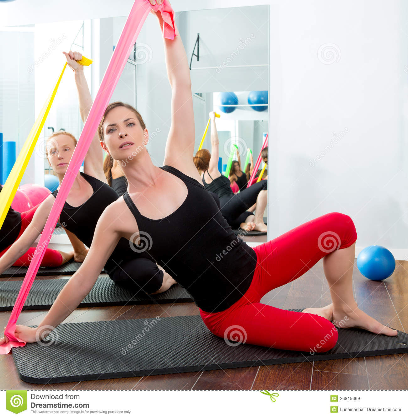 Woman Pilates Chair Exercises Fitness Stock Photo: Aerobics Pilates Women With Rubber Bands In A Row Royalty