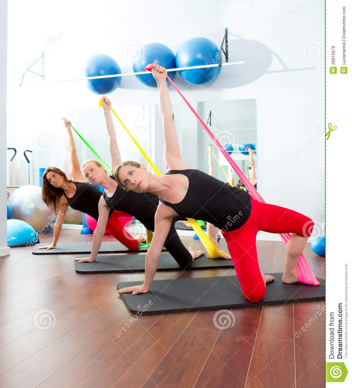 Aerobics Pilates Women With Rubber Bands In A Row Royalty
