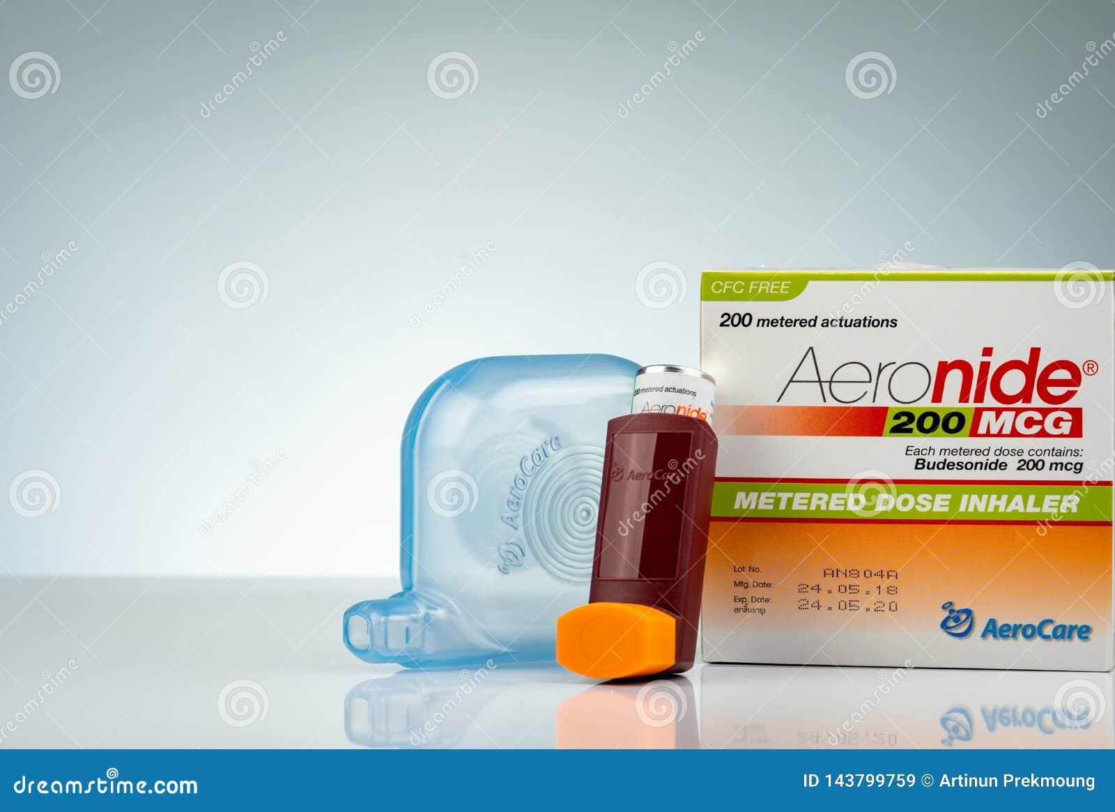 Aeronide inhaler and plastic spacer isolated on gradient background. Asthma inhaler. Steroids inhaler medicine for asthma.