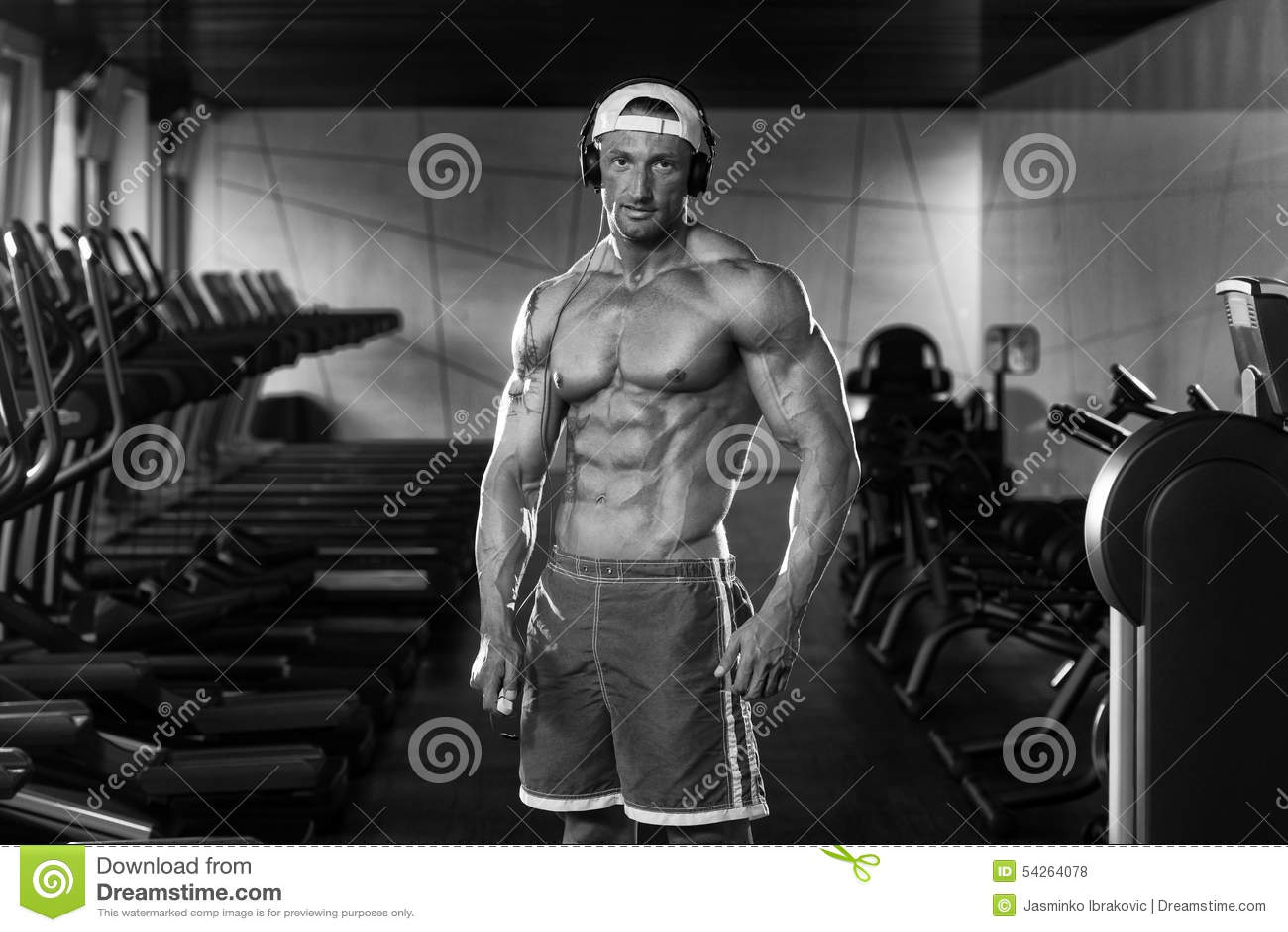 Aesthetic Man Listening Music In Modern Fitness Center Stock