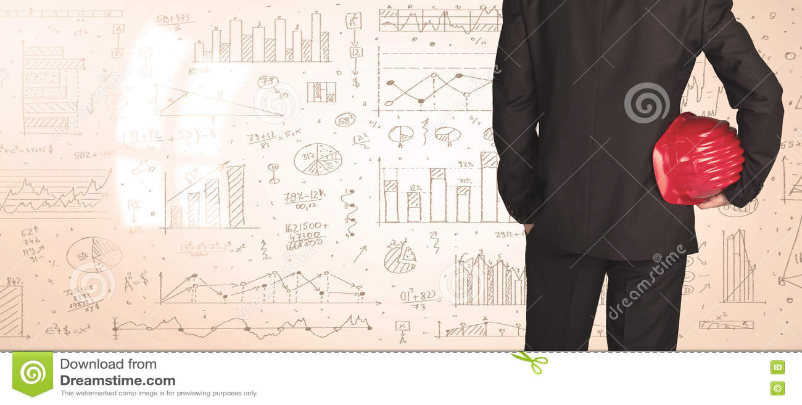 Affärsman med diagram och grafer