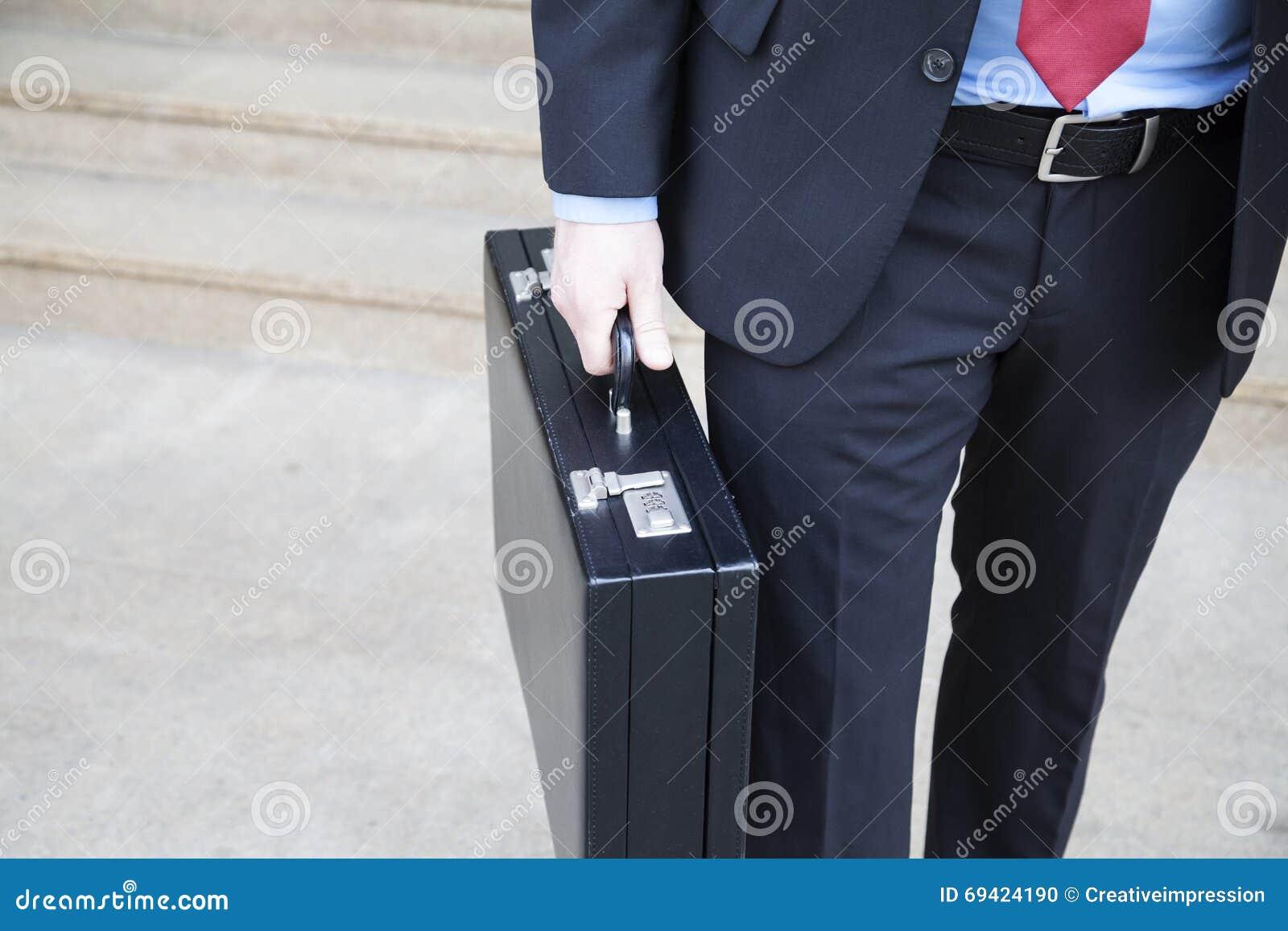 Affärsman med portföljen