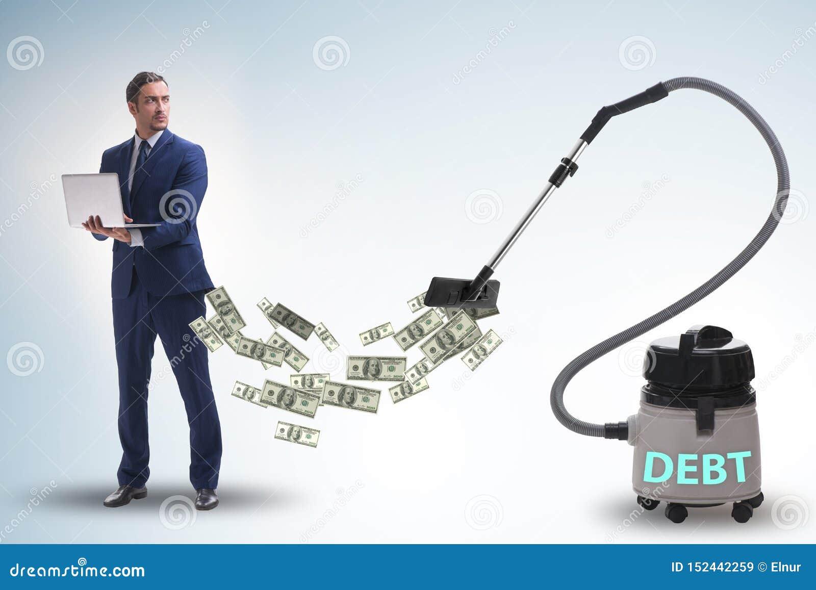 Affärsman och dammsugare som suger pengar ut ur honom