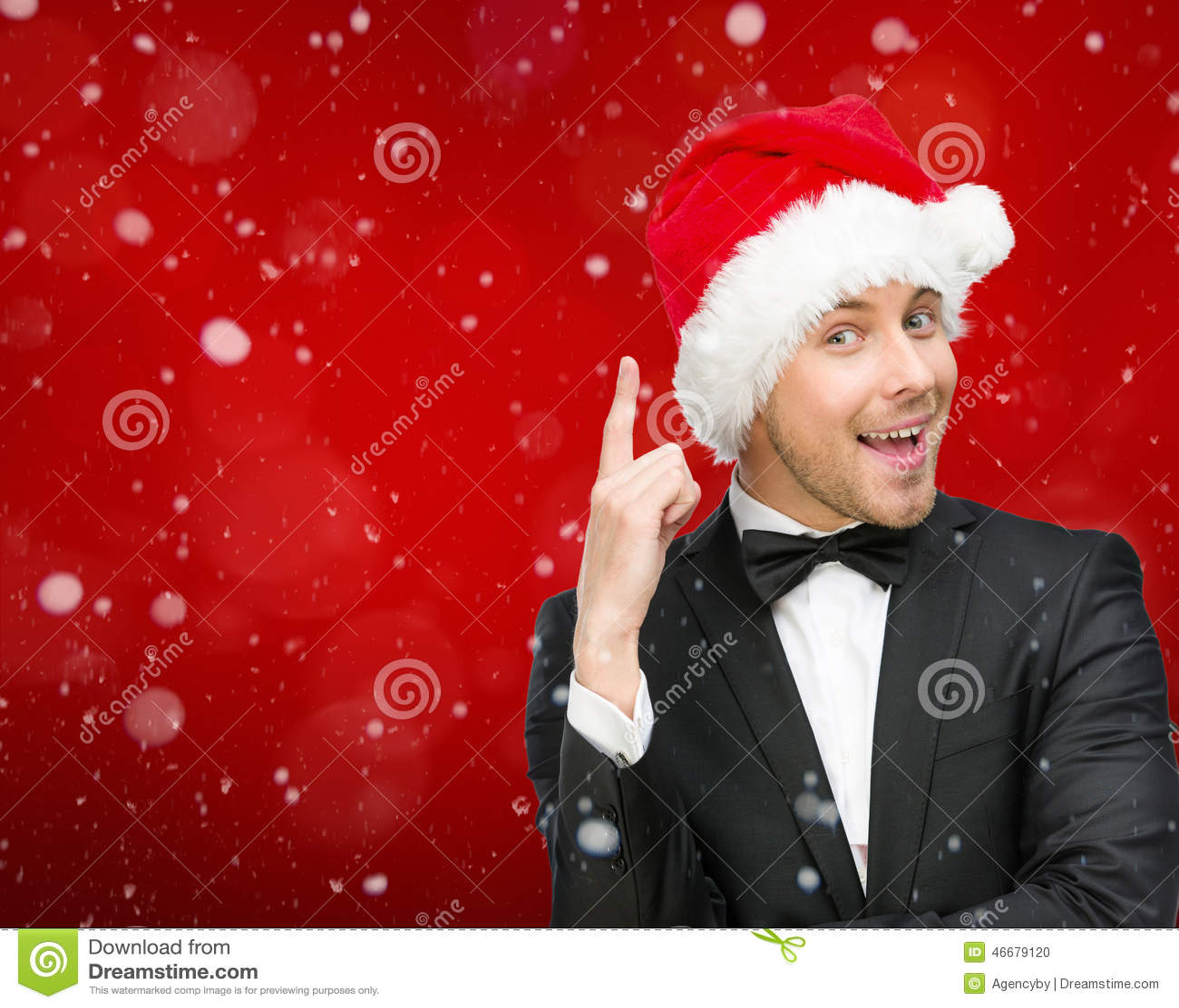 Affärsman som bär gester för Santa Claus lockuppmärksamhet