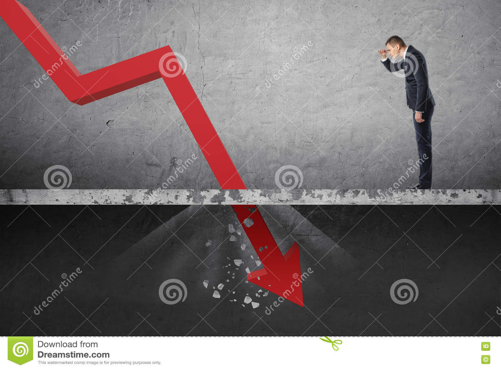 Affärsman som ner ser på den fallande röda pilen som förstör en konkret barriär