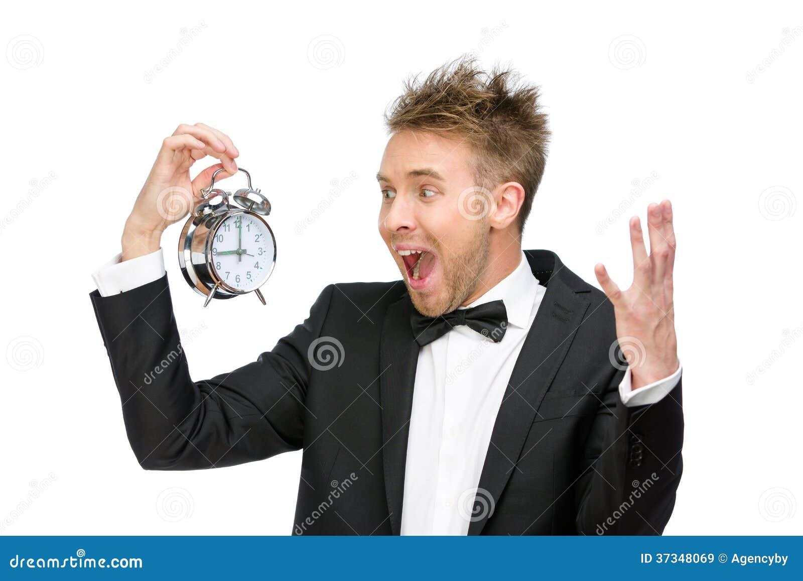 Affärsman som ser ringklockan och att ropa