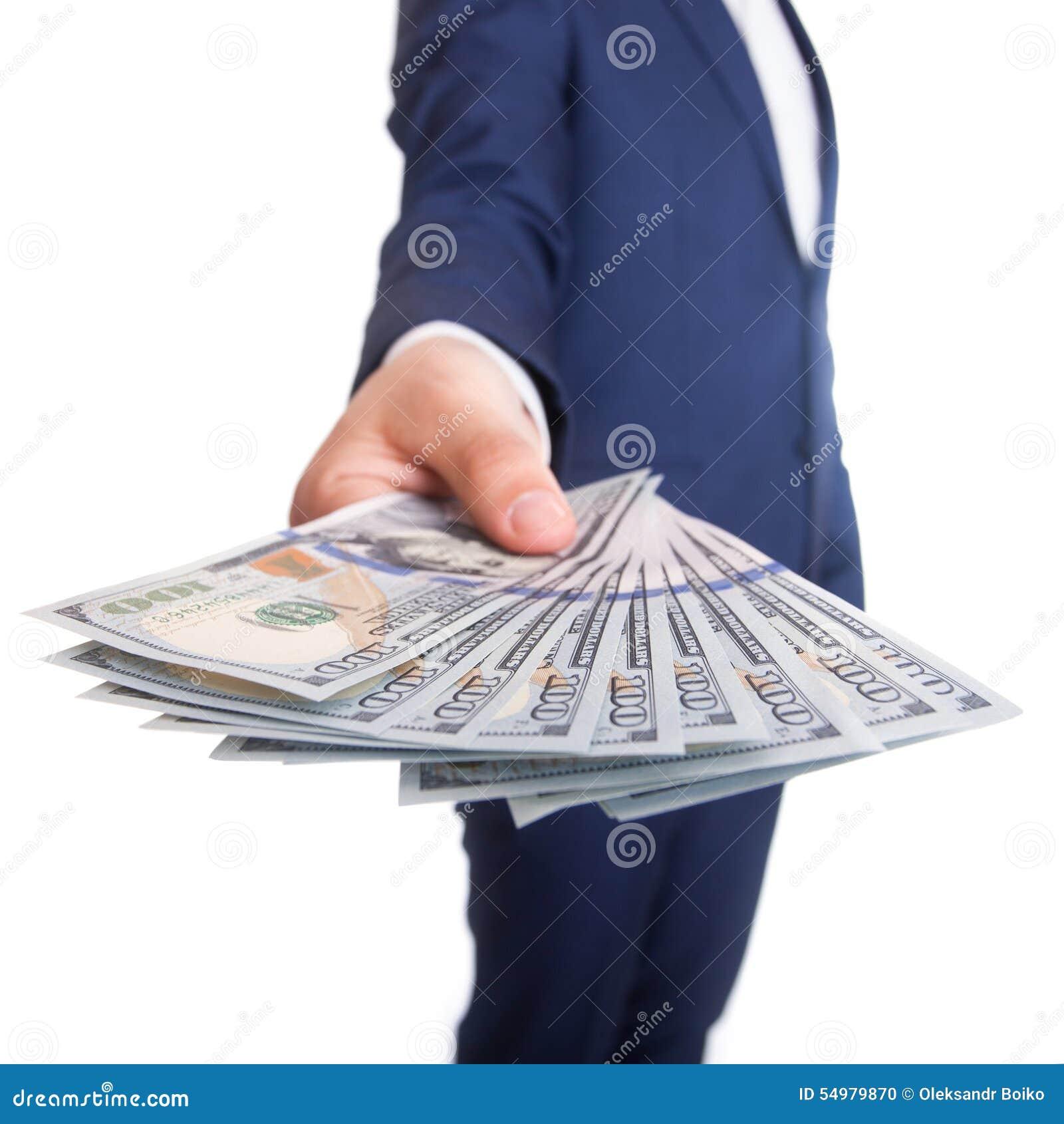 Affärsman som visar en spridning av dollaren