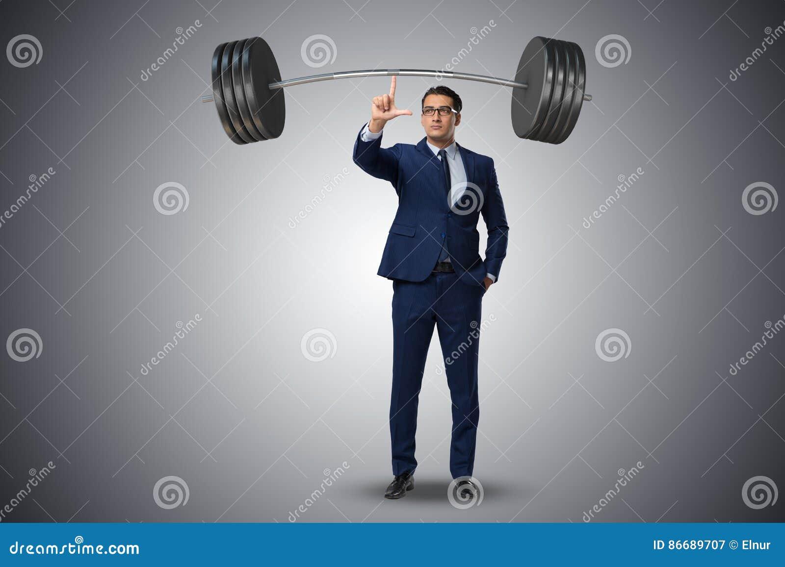 Affärsmannen med skivstången i tungt lyftande begrepp