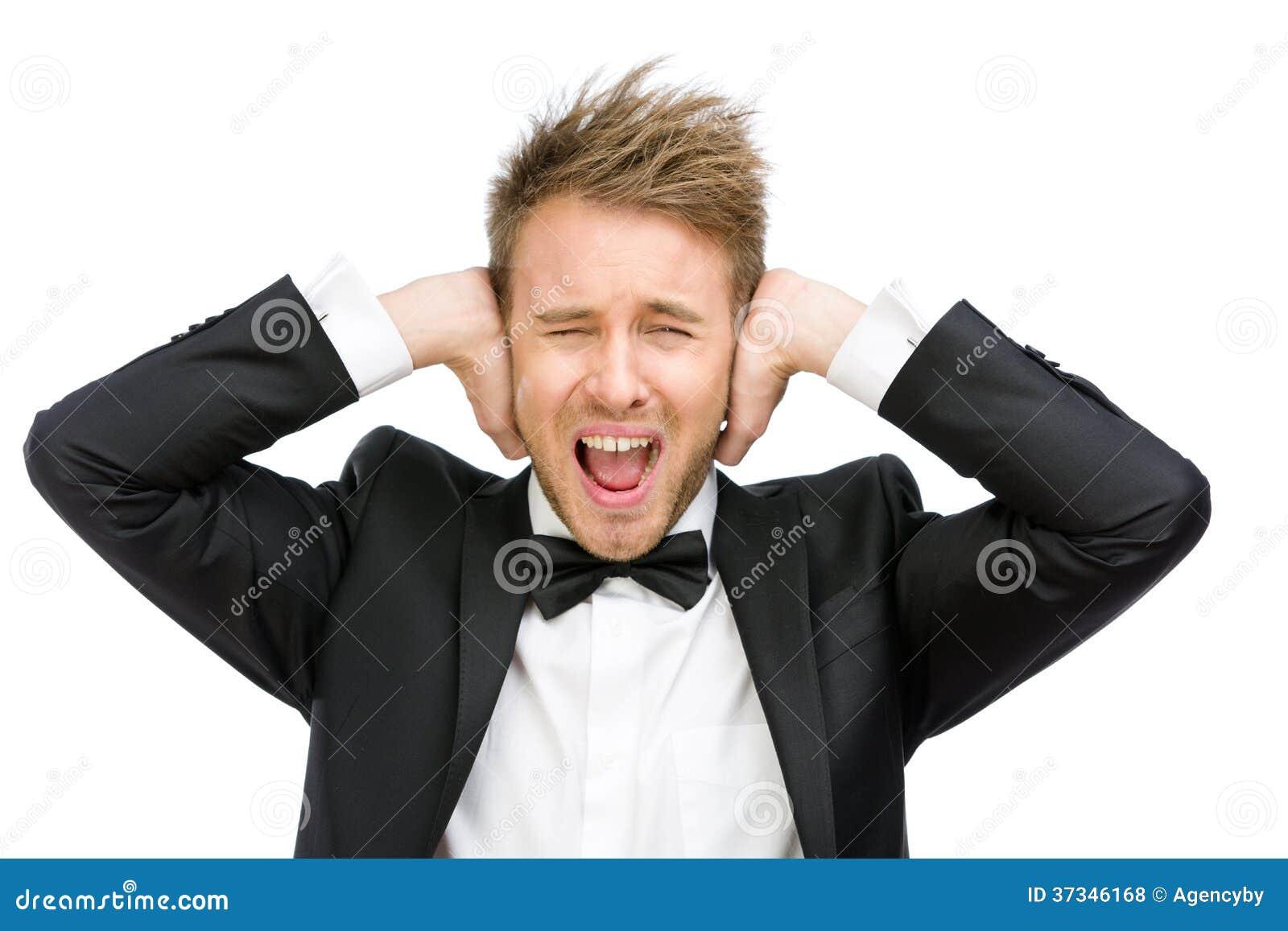 Affärsmannen med stängda ögon stänger hans öron
