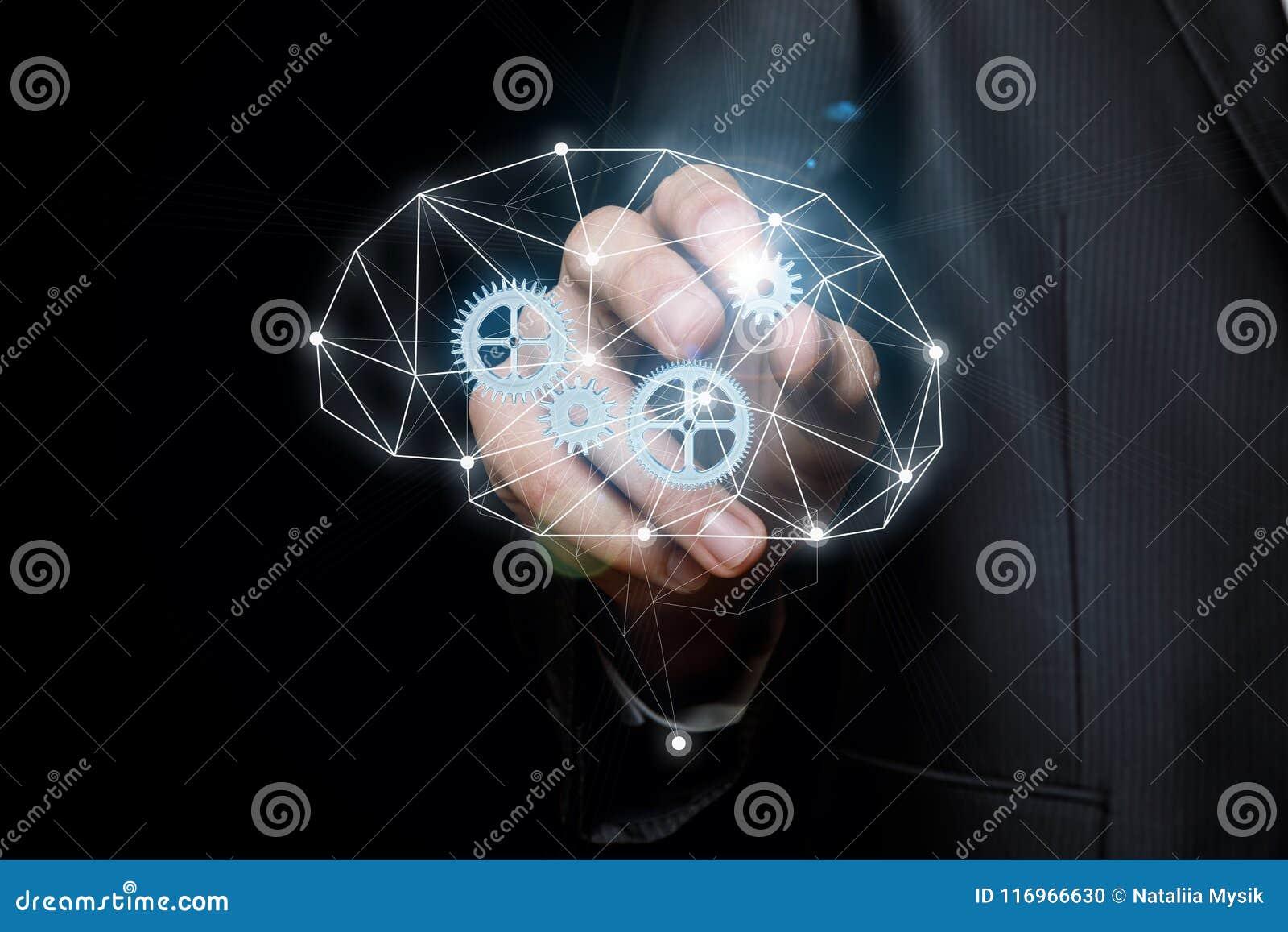 Affärsmannen sätter in kugghjulet in i mekanismen av att tänka