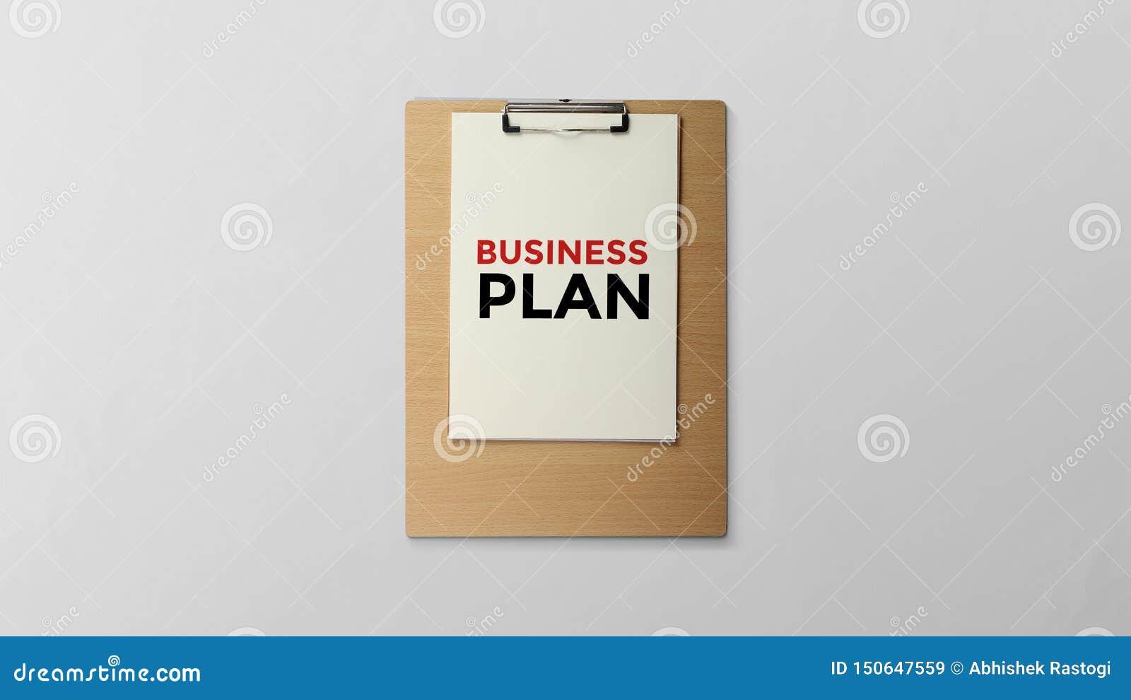 Affärsplan som är skriftligt på skrivplattan