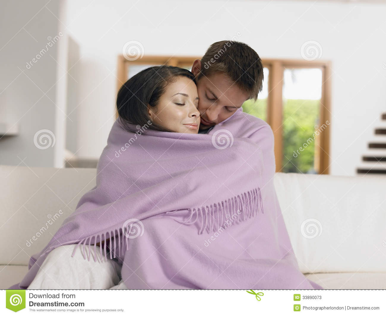 Affectionate Couple Wrapped In Blanket