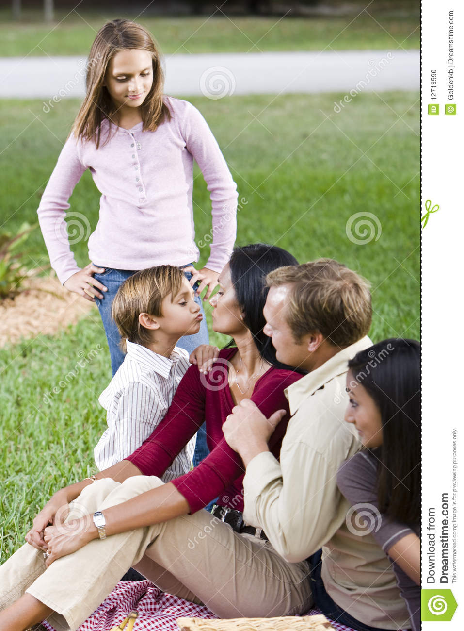 Affectionate family of five together in park