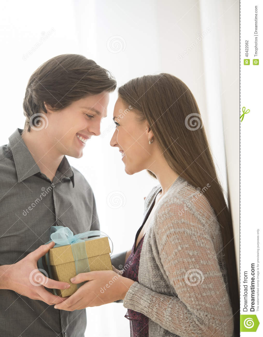 Affectionate Man Giving Birthday Gift To Woman