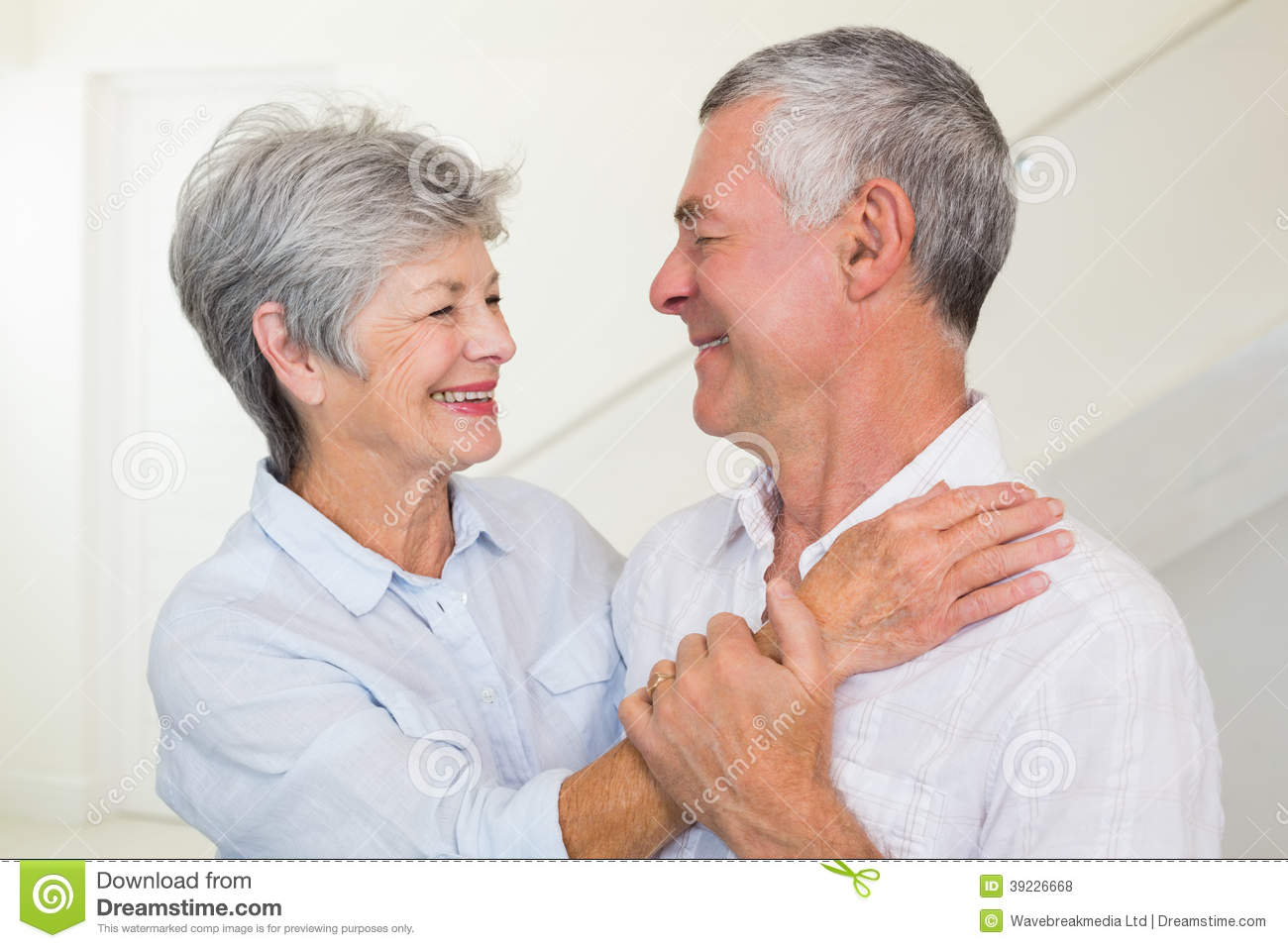 Affectionate retired couple smiling at each other stock for House plans for retired couples