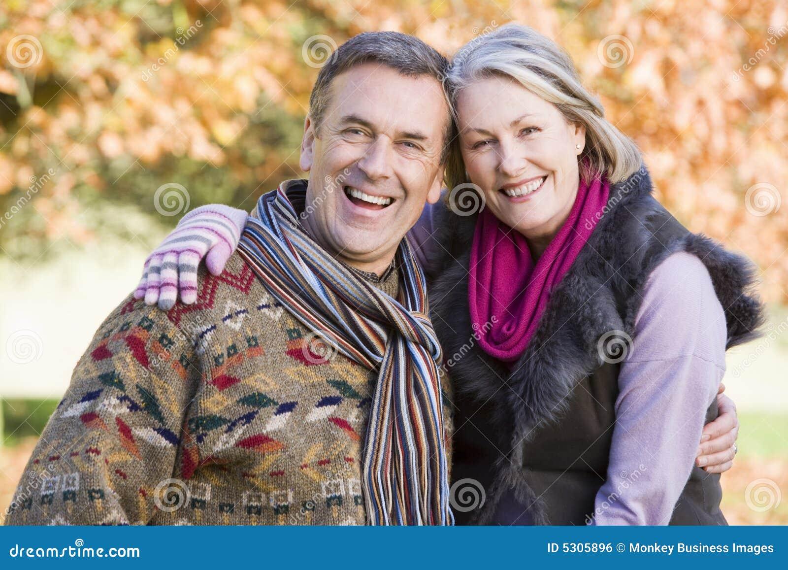 Affectionate senior couple on autumn walk