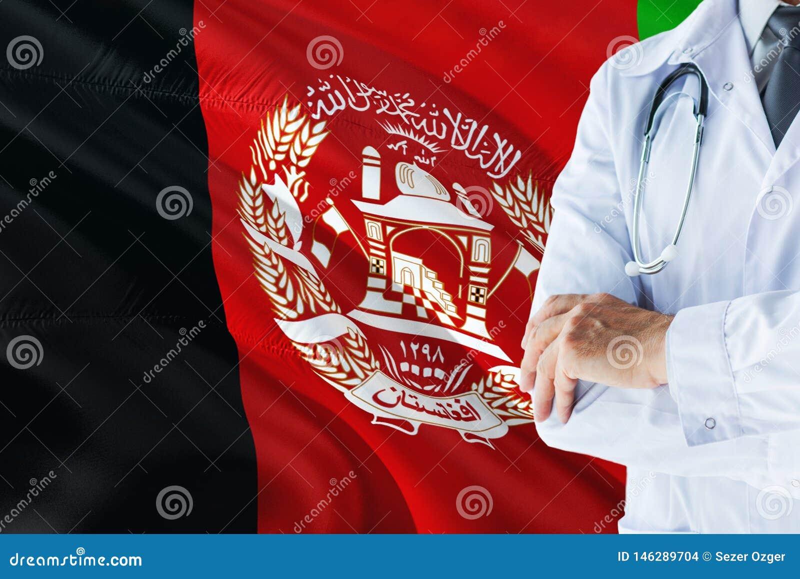 Afgańczyk Doktorska pozycja z stetoskopem na Afganistan flagi tle Krajowy system opieki zdrowotnej pojęcie, medyczny temat