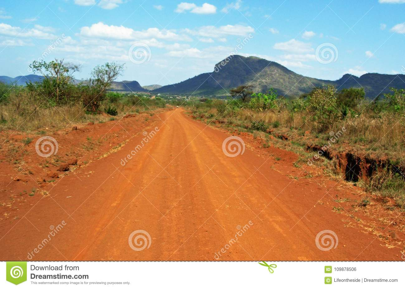 Stunning background landscape driving red dusty dirt roads of Africa