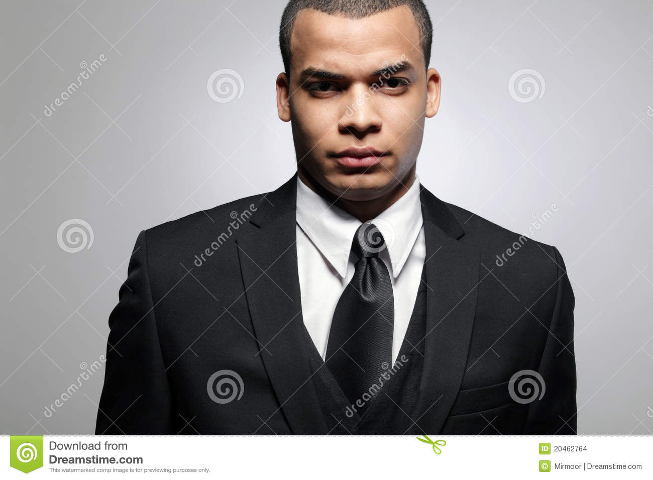 African-American business man in black suit.