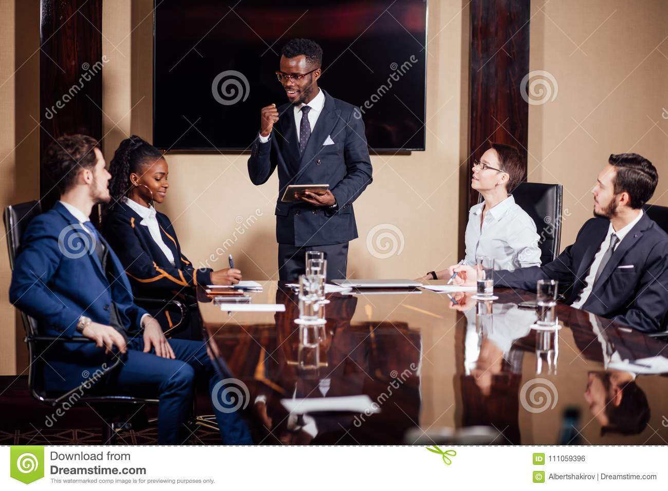African American Business Man Giving Presentation To