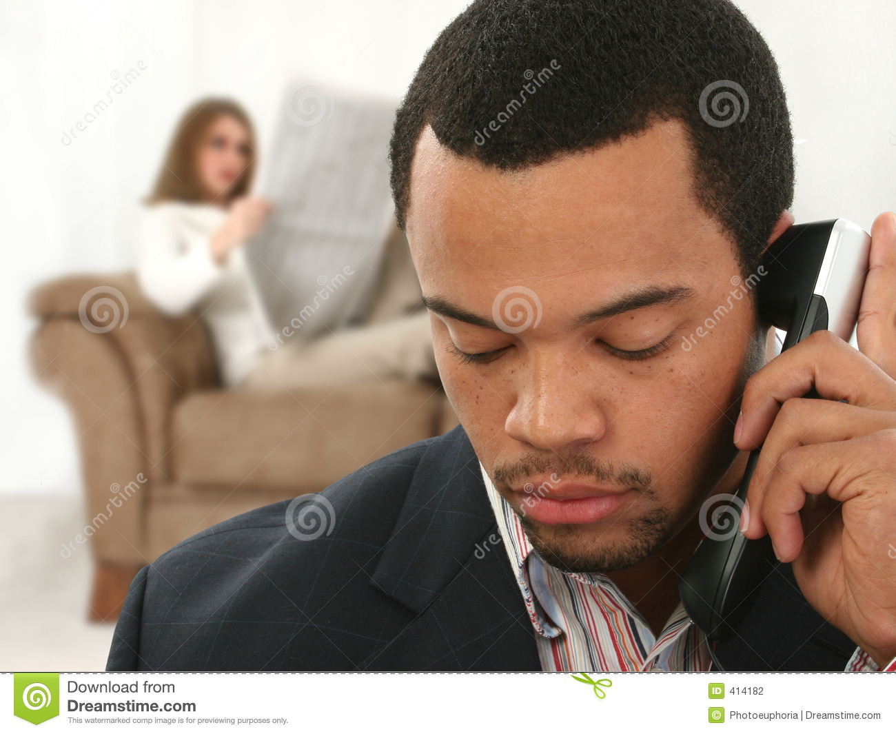 African American Business Man on Phone at Ho