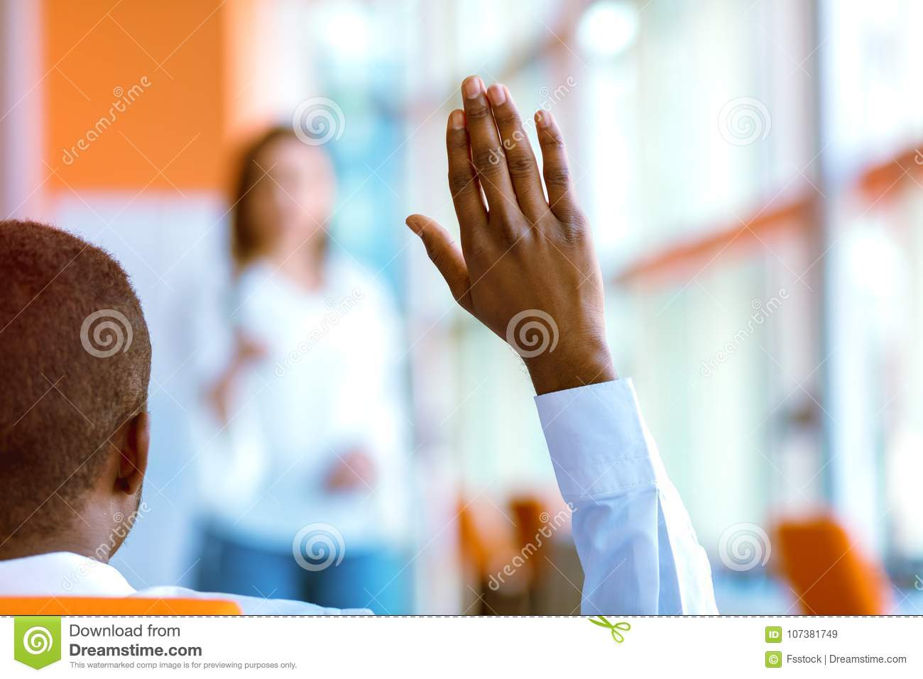 African american Business people Raising there Hand Up at a Conference to answer a question