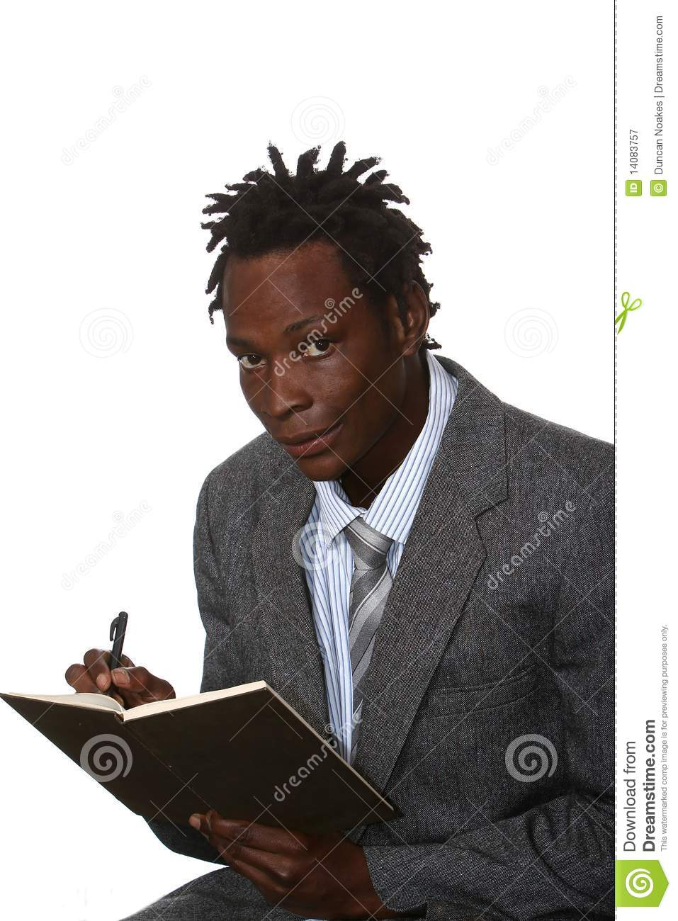 Young African American business man with dreadlocks hairstyle writing ...