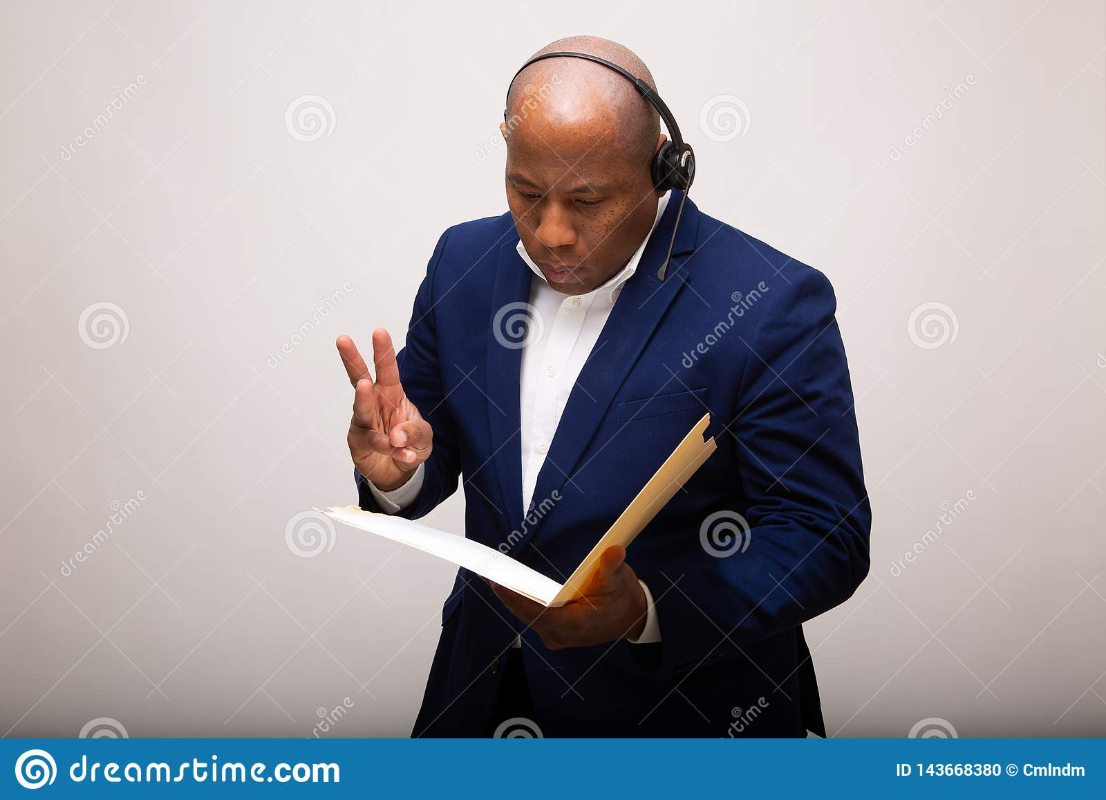 African American Businessman Looks Through File