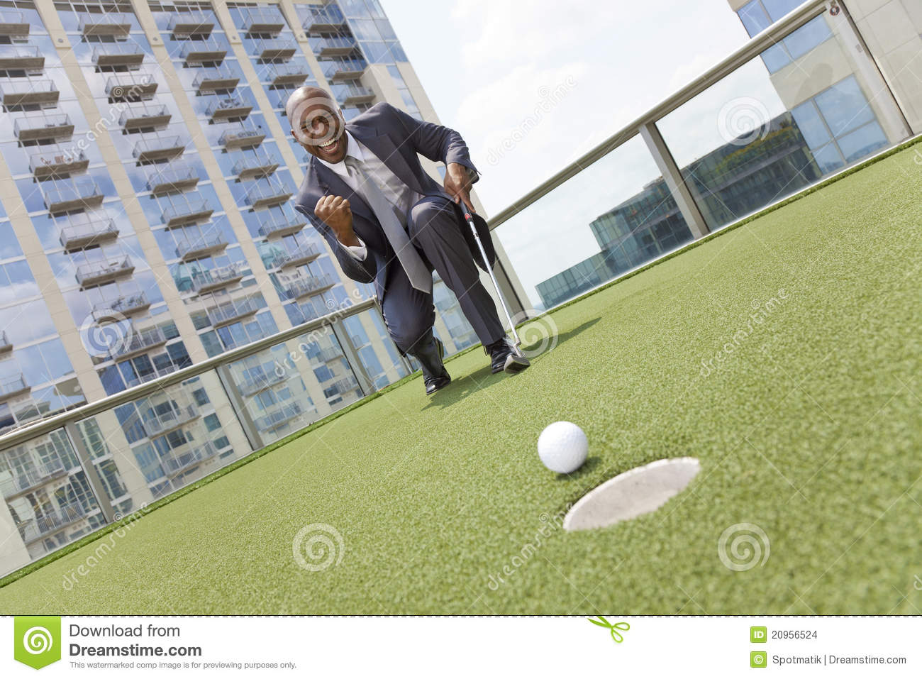 African American Businessman Playing Rooftop Golf