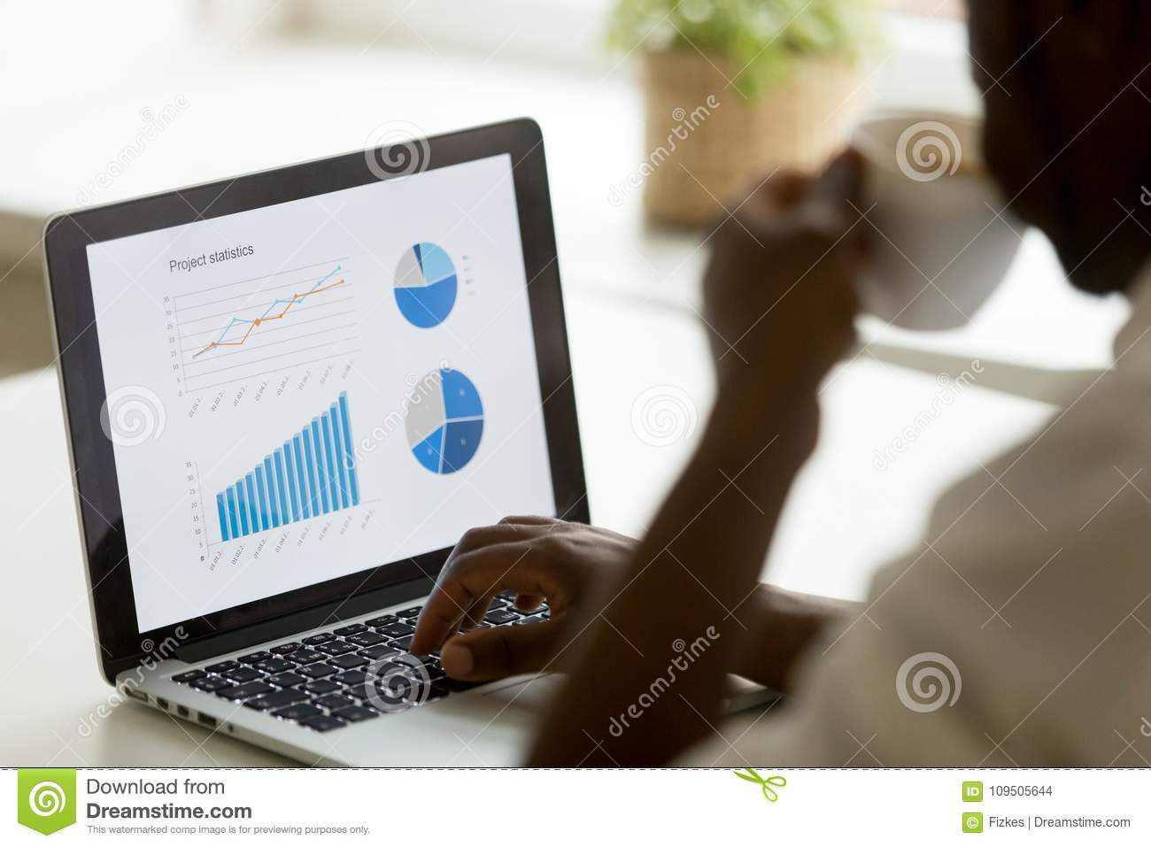 African american businessman working with project statistics on
