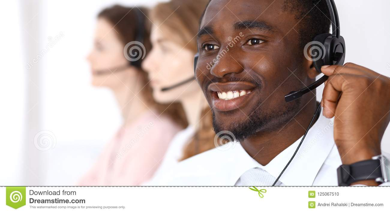 African american call operator in headset. Call center business or customer service concept
