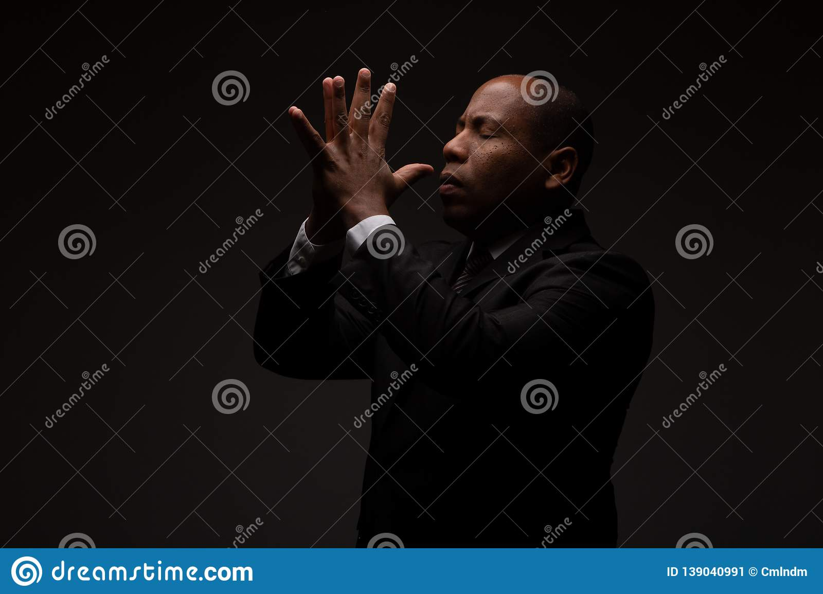 African American Christian Man Praying and Seeking Guidance from God
