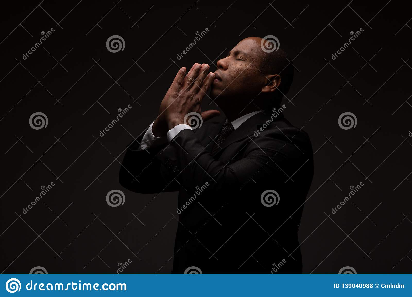 African American Christian Man Praying and Seeking Guidance from God