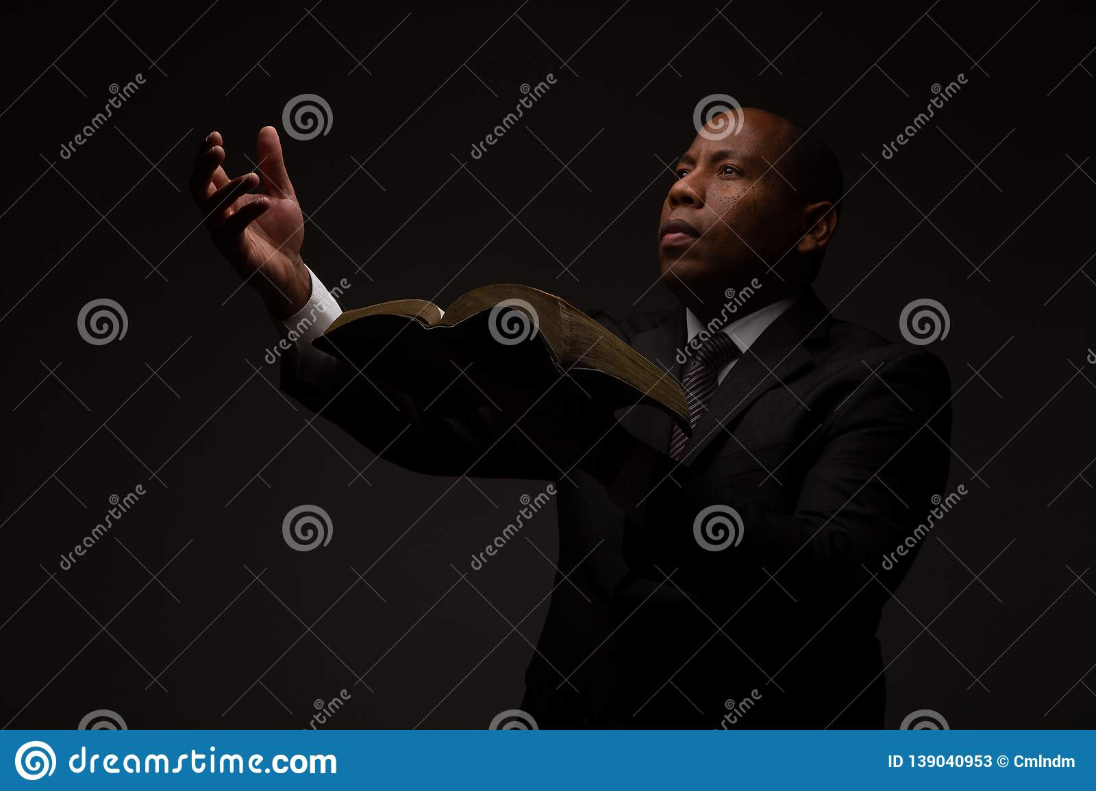 African American Christian Man with the Scriptures in Hand Making an Appeal