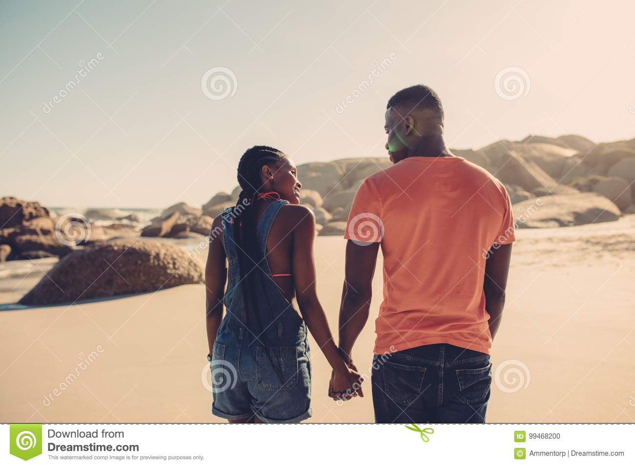 Man and woman in love strolling on the beach