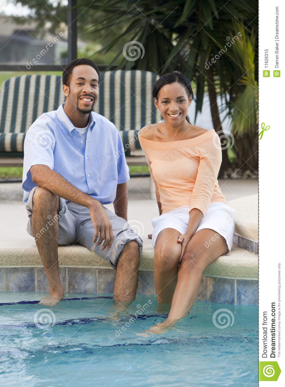 African American Couple By Swimming Pool