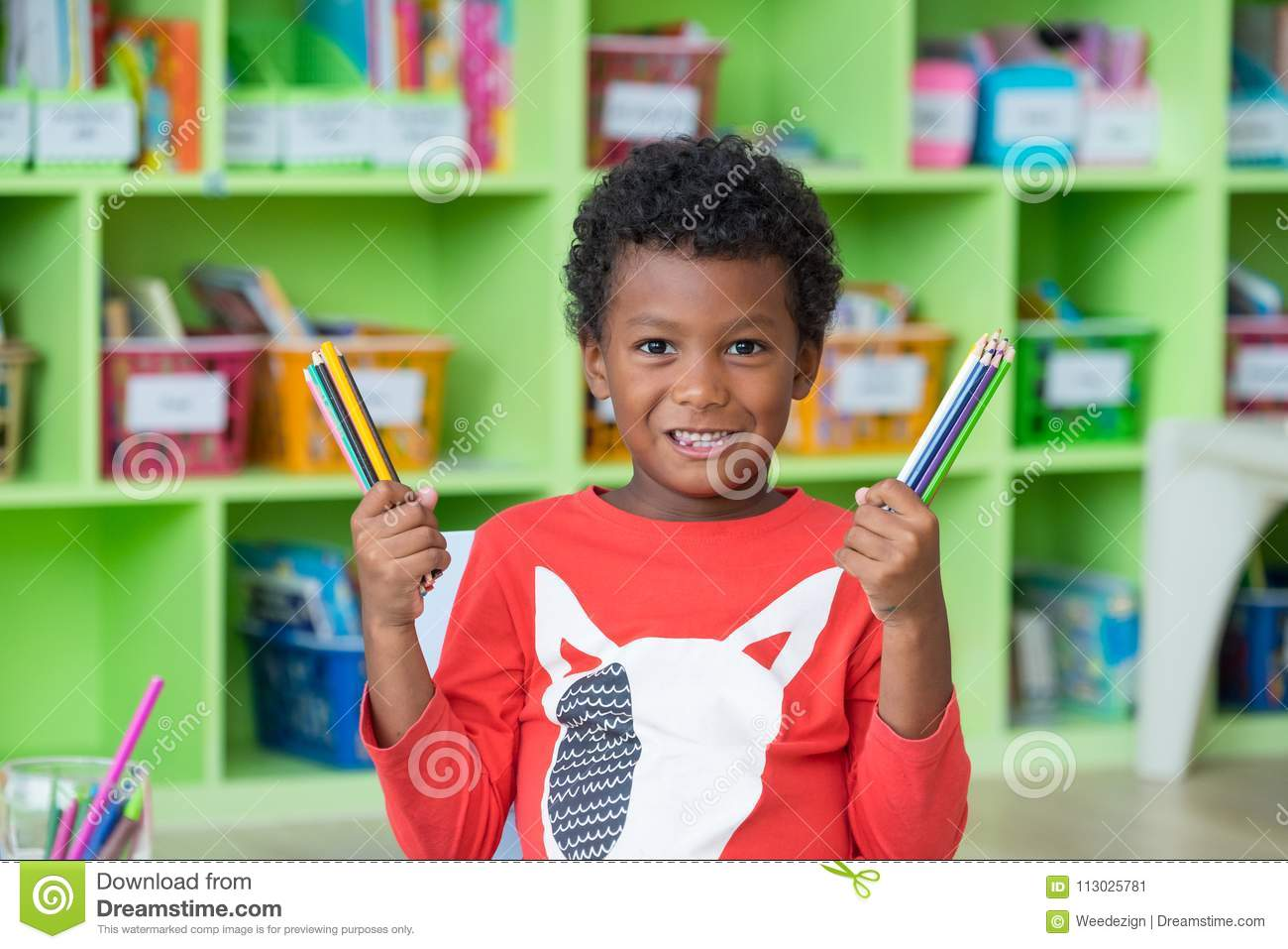 African American Ethnicity Kid Holding Group Of Color Pencil Smi ...