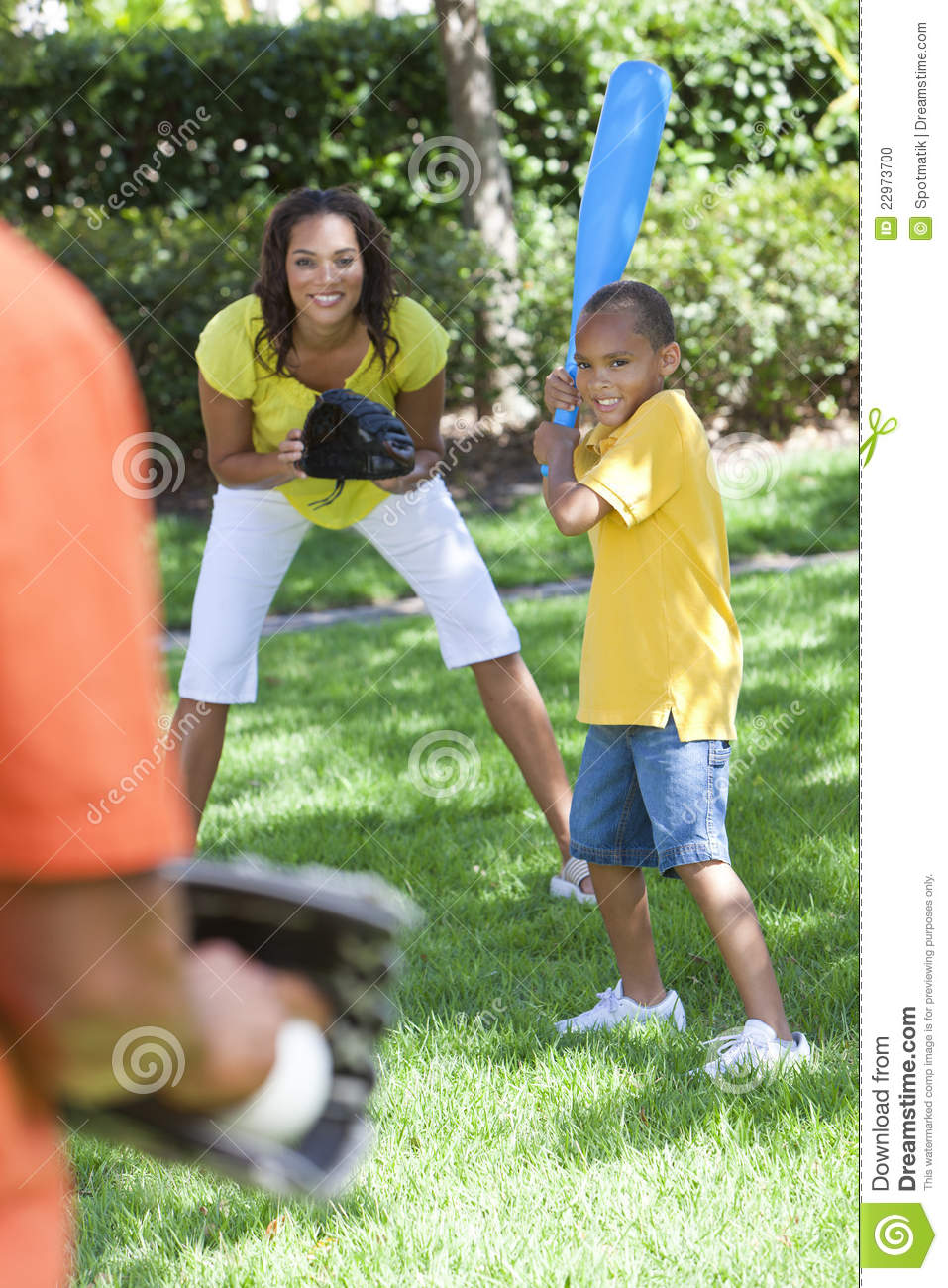 African American Family Playing Baseball Stock Photo