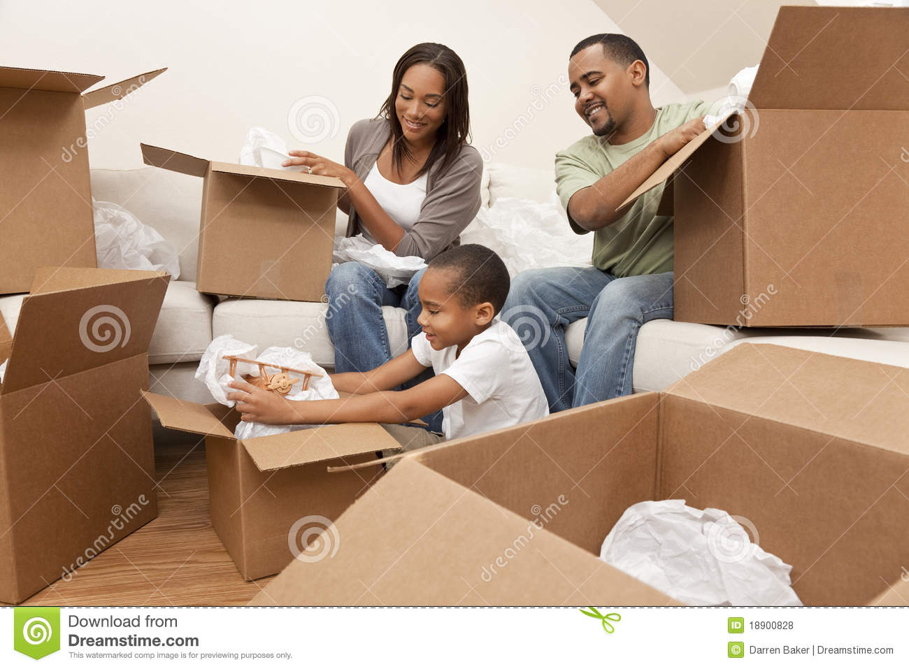 African american family unpacking moving boxes royalty When is the best time to move house