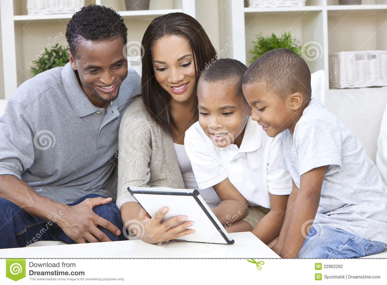 African American Family Using Tablet Computer