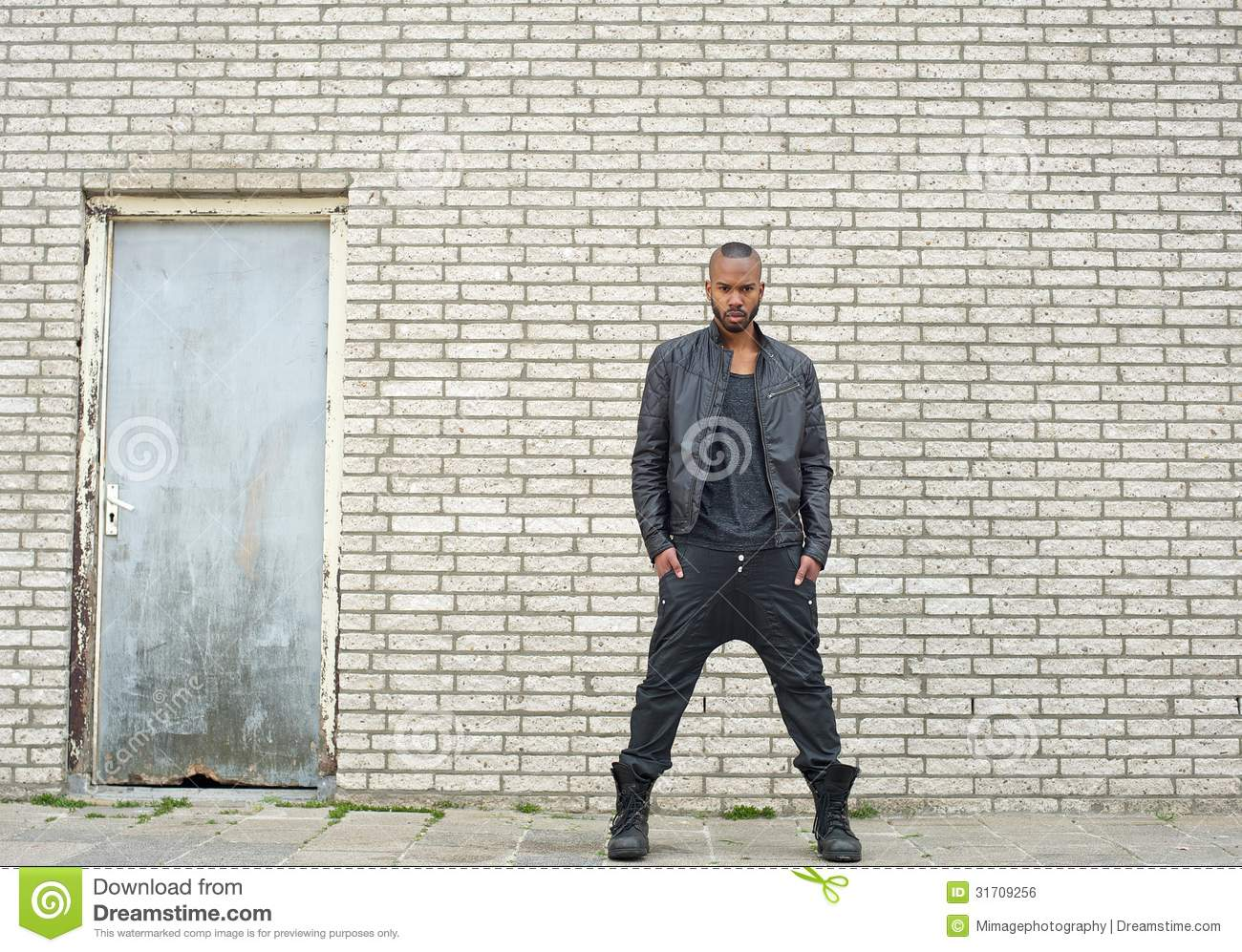 African American Fashion Model Standing In Urban Environment