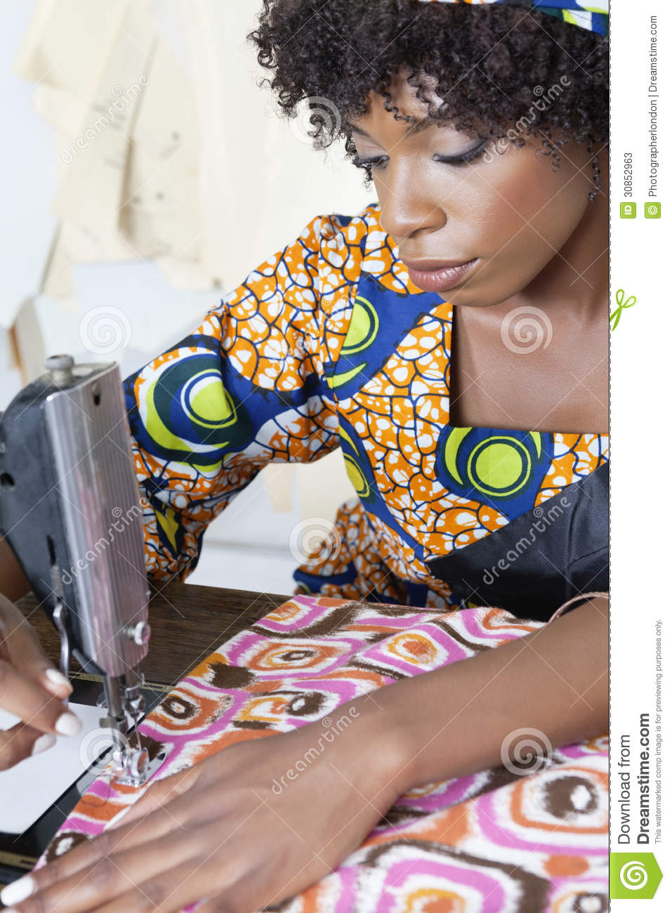 African American Female Tailor Stitching Patterned Cloth
