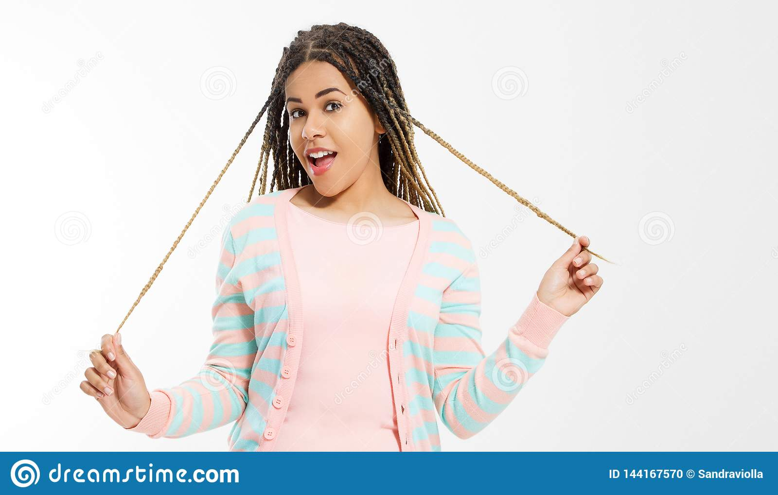 African american girl in fashion clothes on white background. Woman hipster with afro hair style. Copy space. Banner