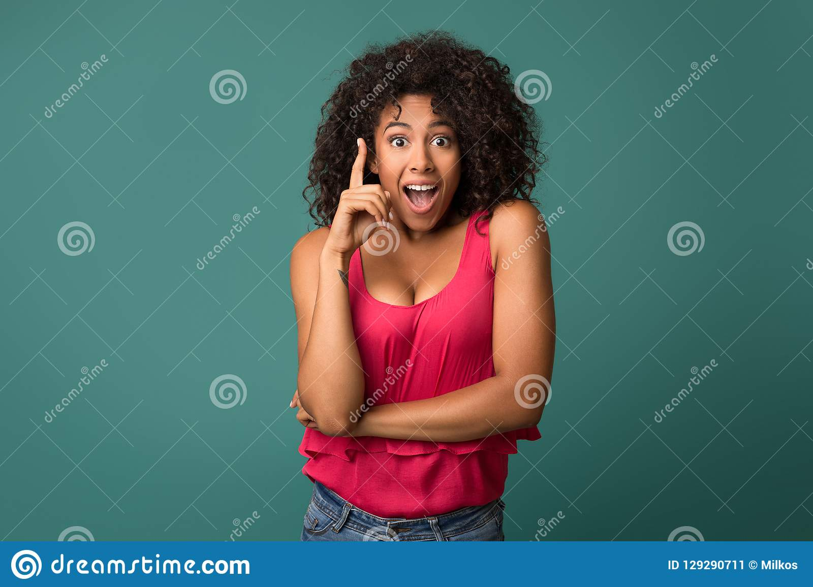 African-american girl having idea against blue background