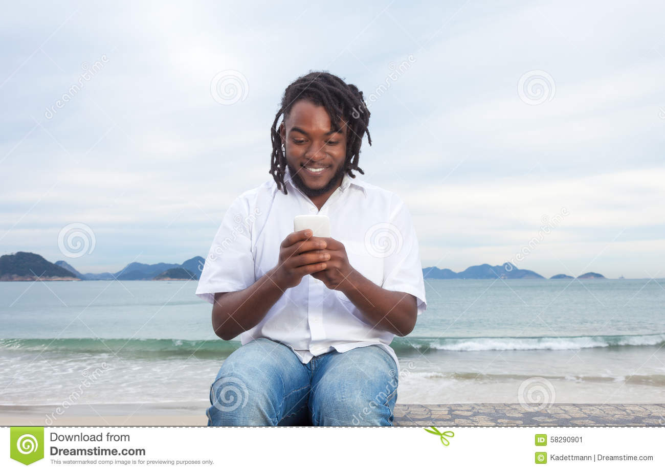 Download African American Guy With Dreadlocks And White Shirt Typing Message Stock Image - Image of freak, black: 58290901