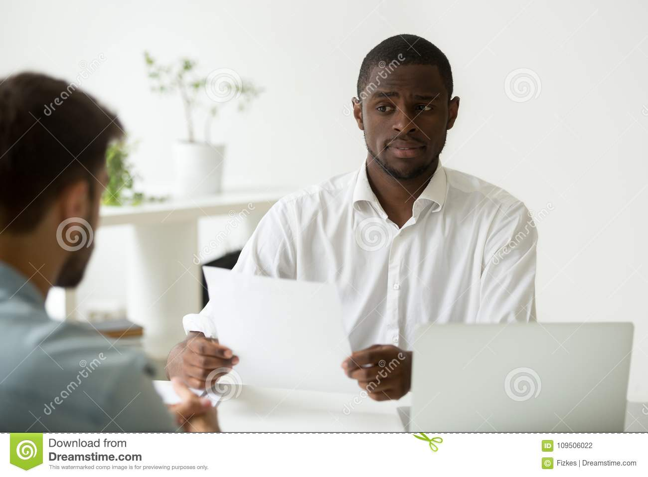 African-american hr manager looking doubtful skeptical about hir