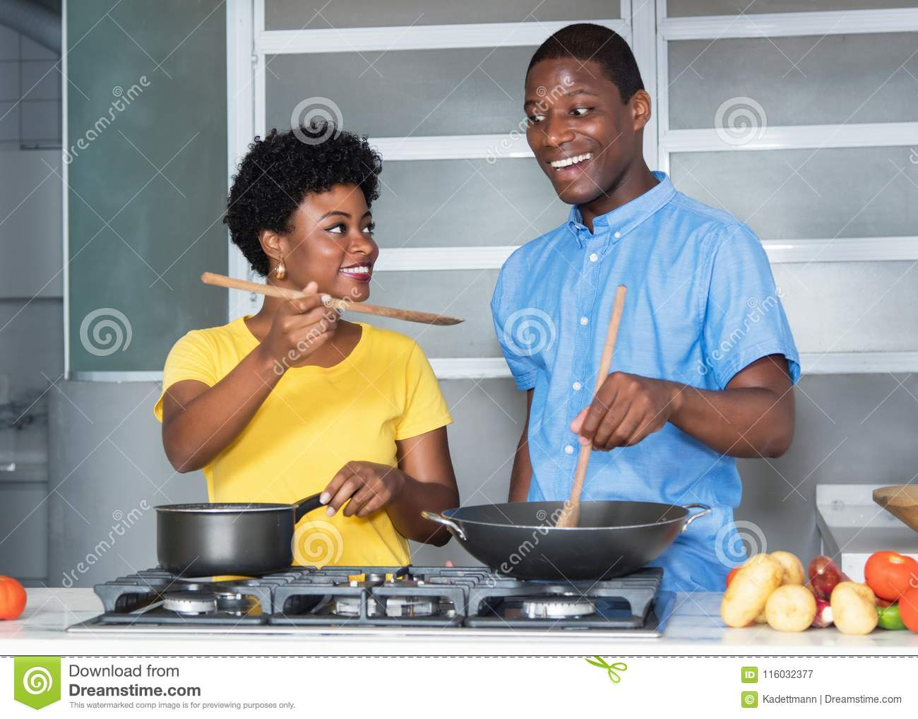 Download African American Love Couple Cooking At Kitchen Stock Image - Image of dish, kitchen: 116032377