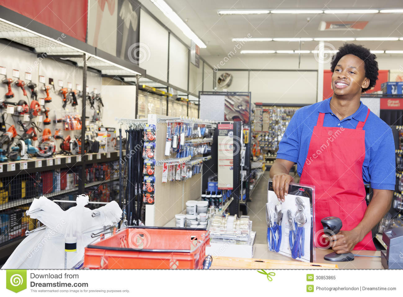 African American Male Store Clerk At Checkout Counter In Super Market ...
